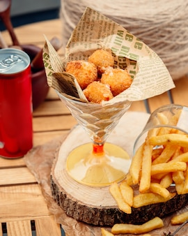 Cheese balls with french fries on the table