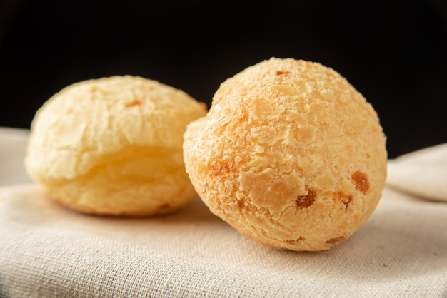 Cheese bread from brazil, arrangement with cheese bread on fabric