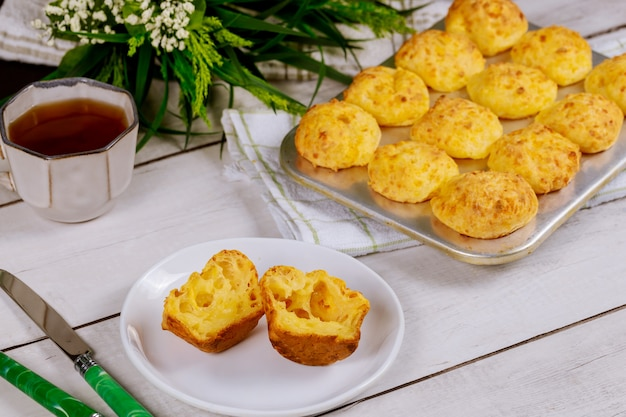 Cheese bread with tea. brazilian traditional cuisine.