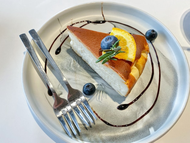 Cheese  cake decorated with blue berry ad orange