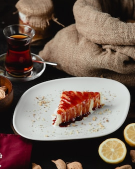 Cheese cake with strawberry syrup