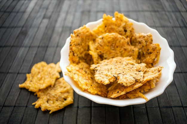 Cheese chips snack in a round white bowl