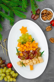 Cheese christmas tree with fresh grapes and rosemary