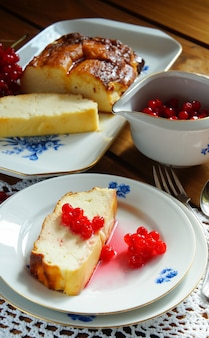 Cheese flan with a berry sauce, viburnum