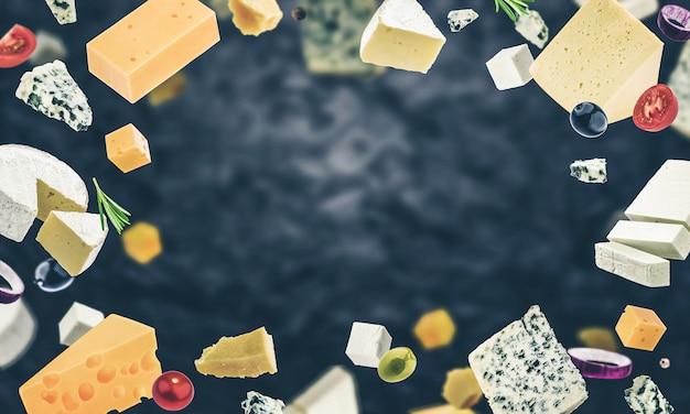 黒、さまざまな種類のチーズのチーズフレーム