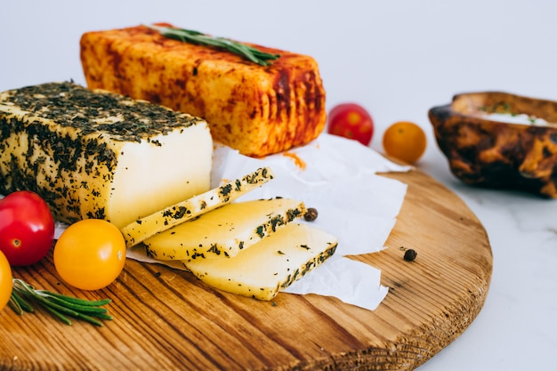 Cheese halumi with mint and smoked paprika on a wooden board
