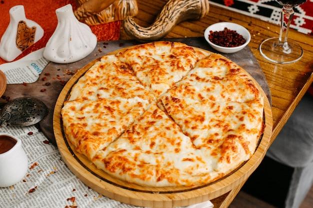 Cheese khachapuri on the table