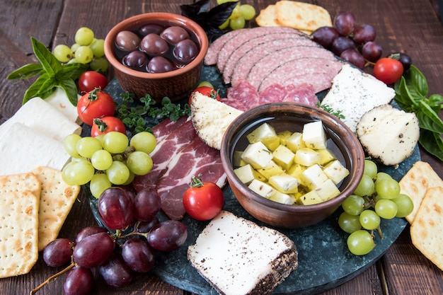 Cheese and meat appetizer selection.