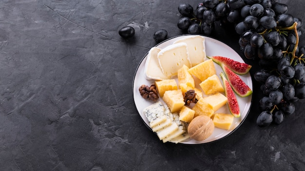 Cheese mix plate with black grapes