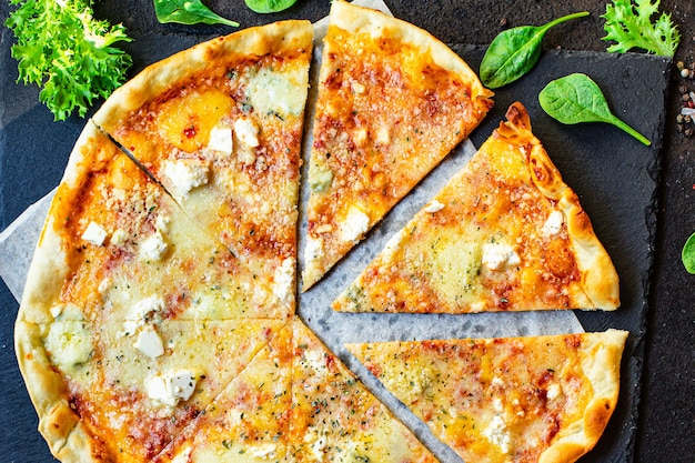 Cheese pizza four types of cheeses and different varieties tomato sauce fresh