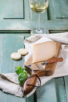 Cheese plate on tablecloth
