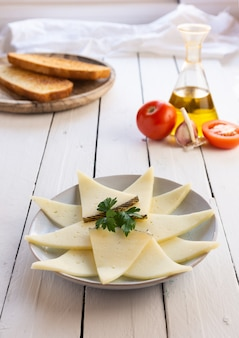 Cheese plate on white wooden table