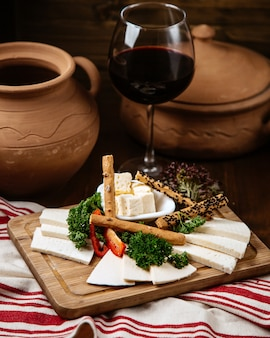 Cheese plate with crispy bread and a glass of wine