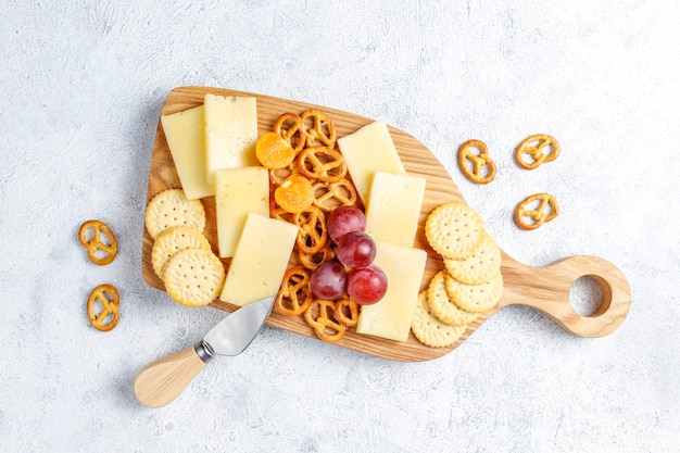 Cheese plate with delicious tilsiter cheese and snacks.