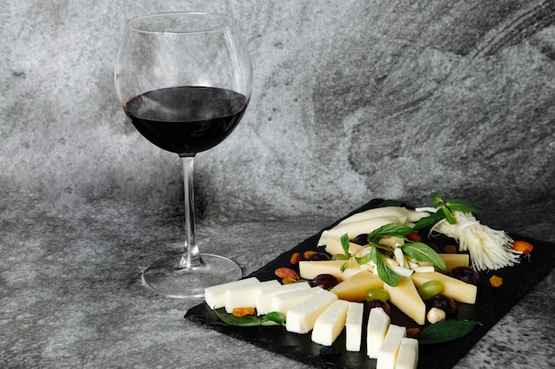 Cheese plate with glass of wine
