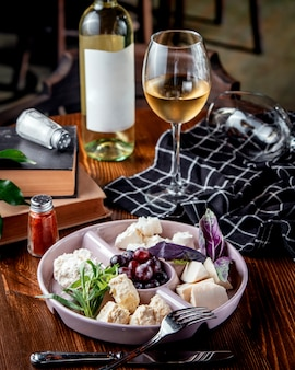 Cheese plate with grapes and white wine