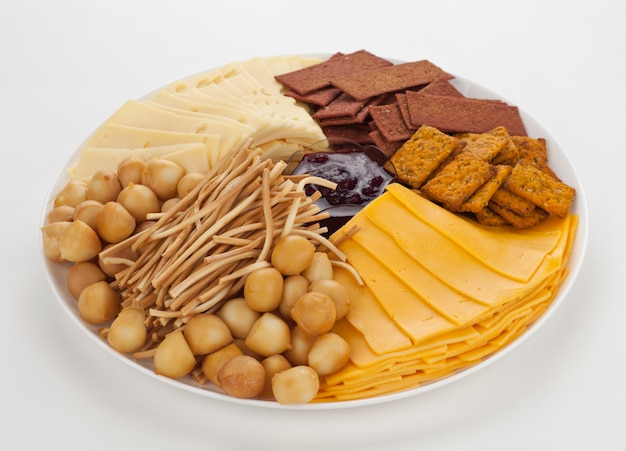 Cheese plate with smoked cheese and bread.