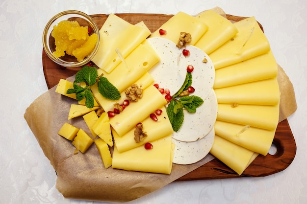 Cheese plate with variety of appetizers on table on event catering
