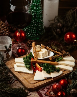 Cheese plate with various cheese and crackers