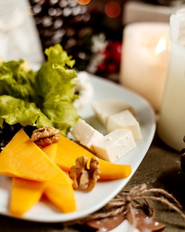 Cheese plate with walnuts and herbs