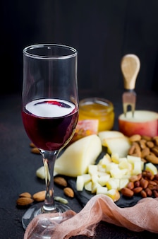 Cheese platter and glass of red wine