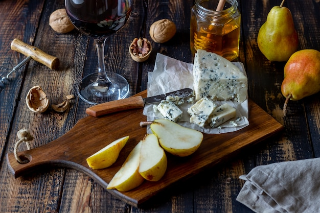 Cheese platter with blue cheese and pear. wine snack. italian cuisine. vegetarian food. healthy eating.