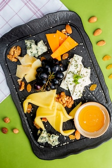 Cheese platter with nuts and grape