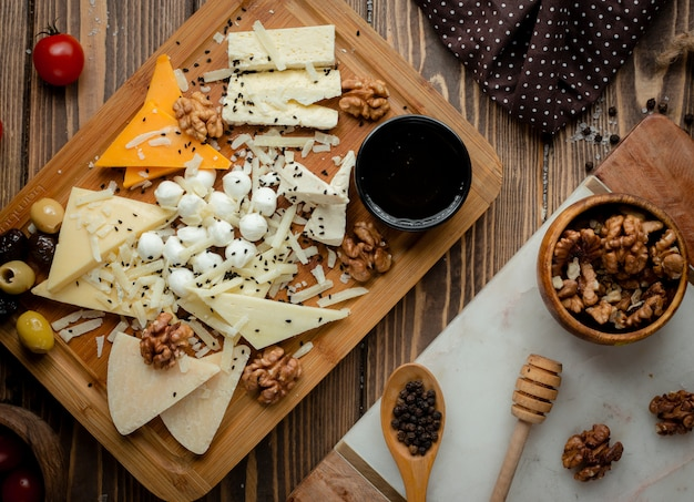 Cheese platter with olives and walnuts.