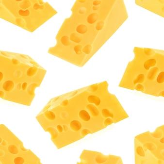 白い背景で隔離のチーズのシームレスパターン