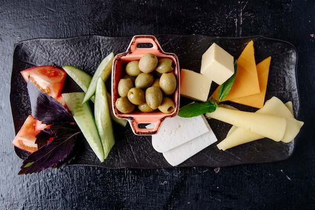 Cheese set olive tomato cucumber top view