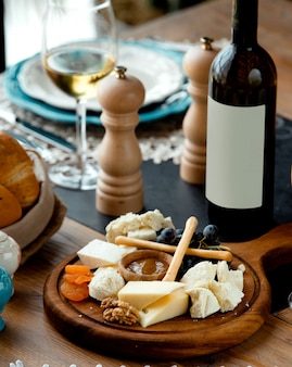Cheese set with red wine on wooden board