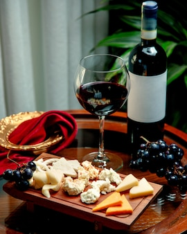 Cheese set with winegrape and glass of wine