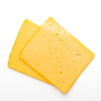 Cheese slice isolated on white. top view