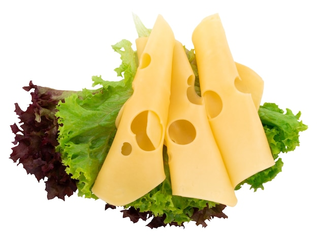 Cheese slices and fresh green lettuce isolated on a white background.