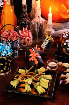 Cheese snack in the form of a witch broom great idea of serving at a buffet table of halloween