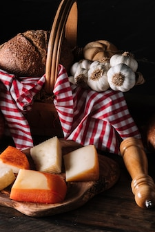 Cheese and spices near basket with food