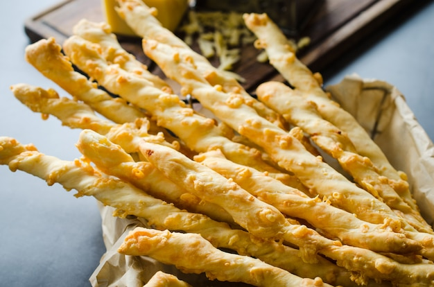 Cheese stick. breadsticks with cheese on dark background. concept for snack or party time