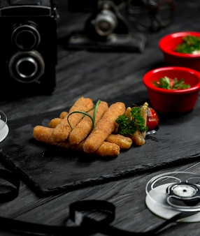 Cheese sticks on a wooden board