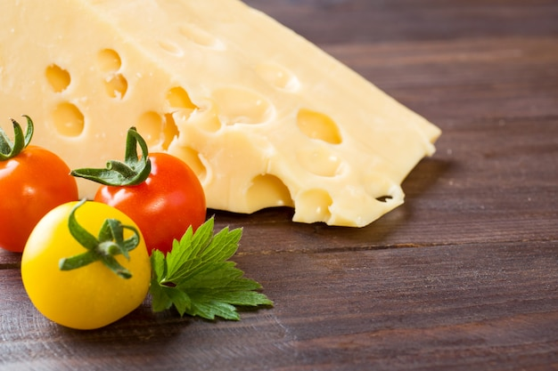 Cheese and tomatoes on wood