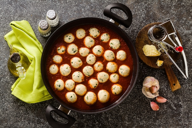 Cheese veggie ricotta meatballs in tomato sauce in a pan. traditional italian cuisine for the whole family, party or restaurant menu