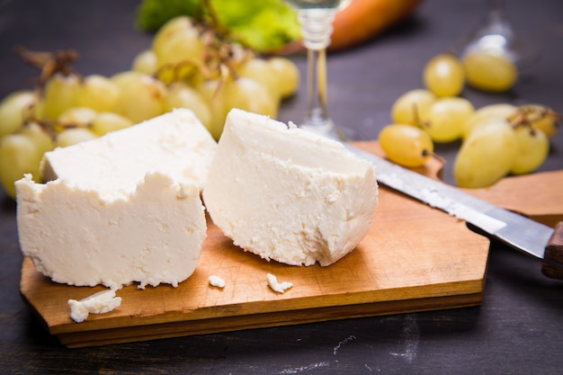 Cheese with grape and wine