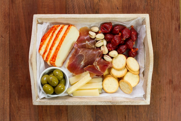 Cheese with grapes and meat