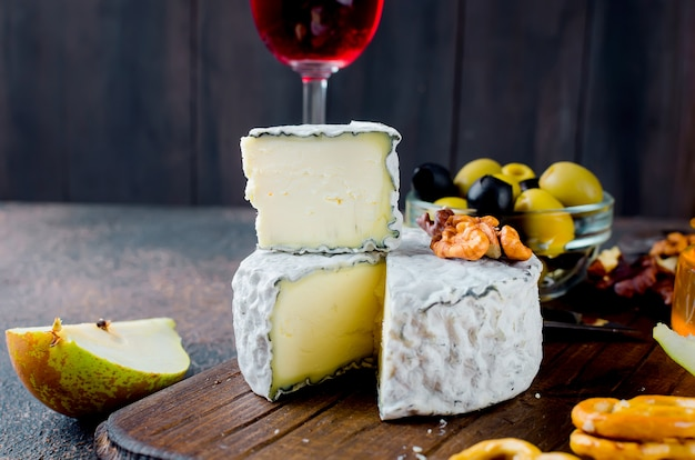 Cheese with mold with berries, snacks and wine