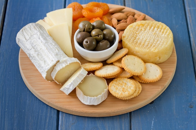 Cheese with olives, dry fruits and cookies