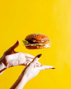 Cheeseburger with bun topped with sesame