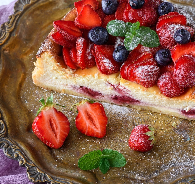 Cheesecake made of cottage cheese and fresh strawberries on a plate, top view