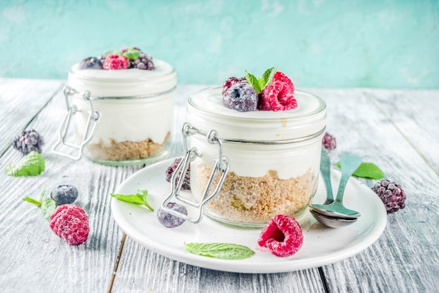 Cheesecake in portioned jars with summer berries