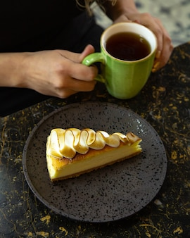 A cheesecake slice topped with burnt meringue cream