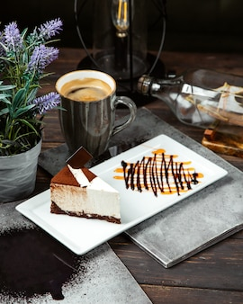 Cheesecake topped with cofee and cup of coffee