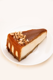 Cheesecake with caramel and nuts on it